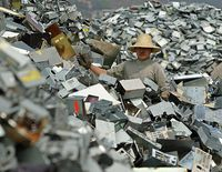 Ewaste-worker-on-a-mountain-of-e-waste